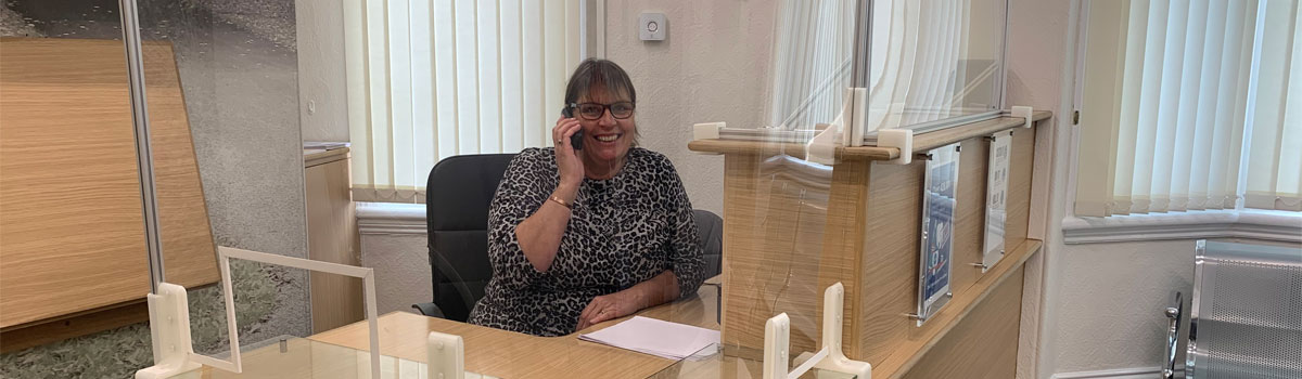 Receptionist on the phone at Ruabon Road Dental Practice in Wrexham