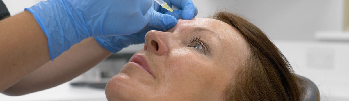 Dentist team with signs for Head, Eyes, Lips and Nose